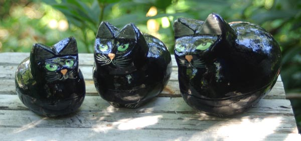 Kashmire Black Cat Urns from the front.