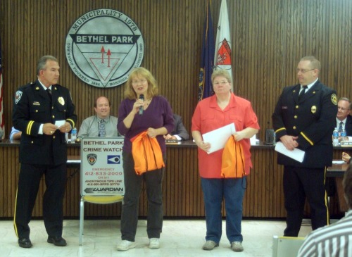 deb and karen giving donation to bethel park